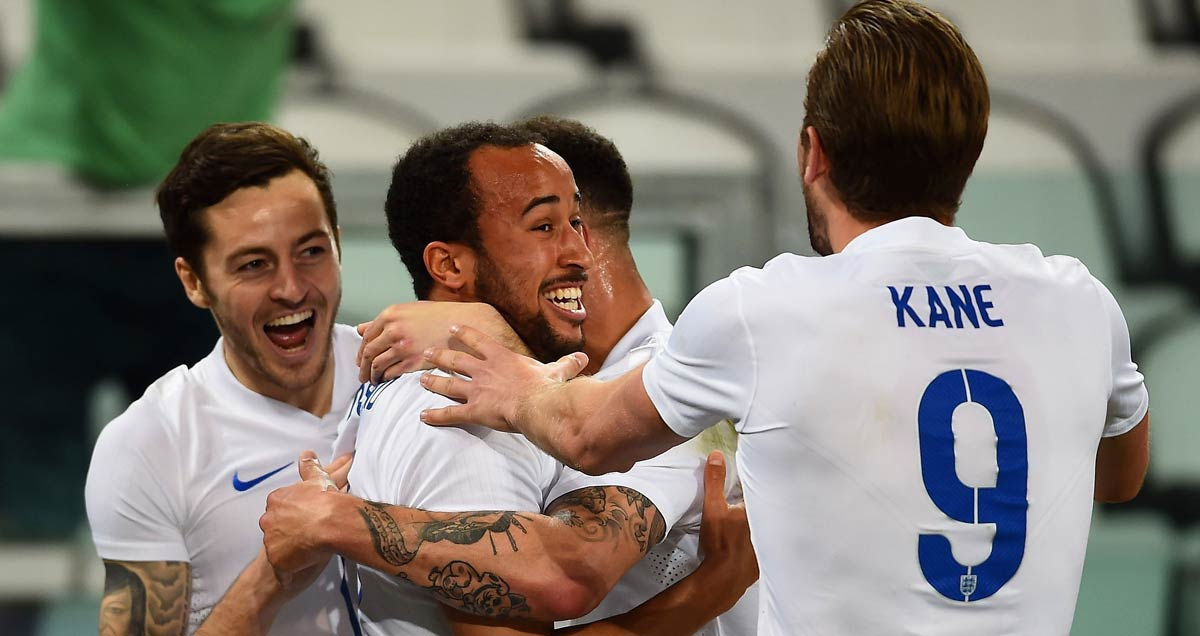Tottenham's Andros Townsend is congratulated on scoring against Italy for England