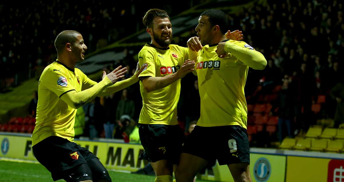 Troy Deeney is embraced by his Watford teammates