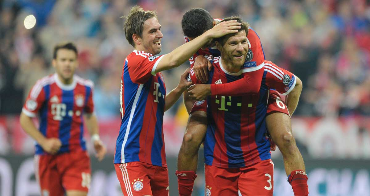 Xabi Alonso is congratulted on his free kick by his Bayern Munchen teammates