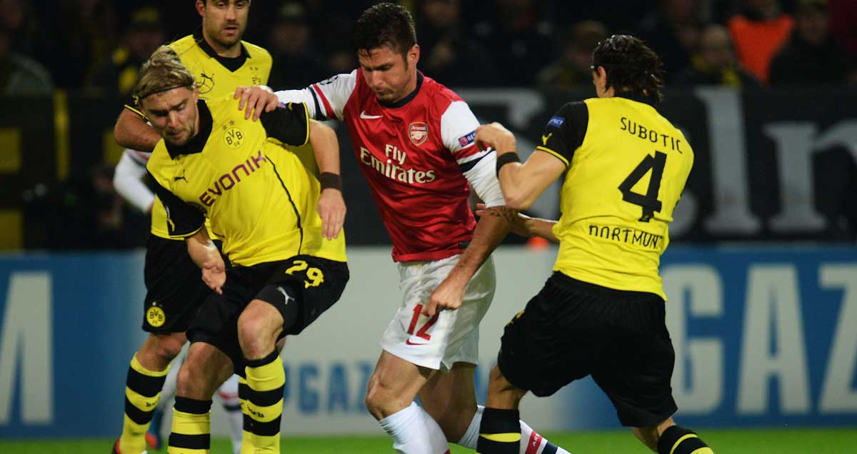 Marcel Schmelzer and Neven Subotic of Borussia Dortmund close down Arsenal's Olivier Giroud
