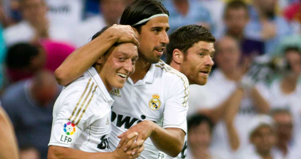Mesut-Ozil-is-congratulated-for-scoring-for-Real-Madrid-v-Mallorca-in-2012