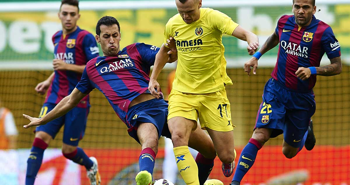 Real-Madrid-loanee-Denis-Cheryshev-is-beseiged-by-Barcelona-defenders