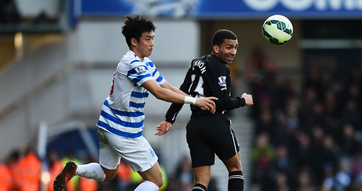 Aaron Lennon defies his small stature to win a header against QPR