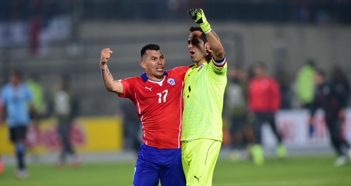 Gary Medel and Claudio Bravo celebrate Chile's win over Uruguay