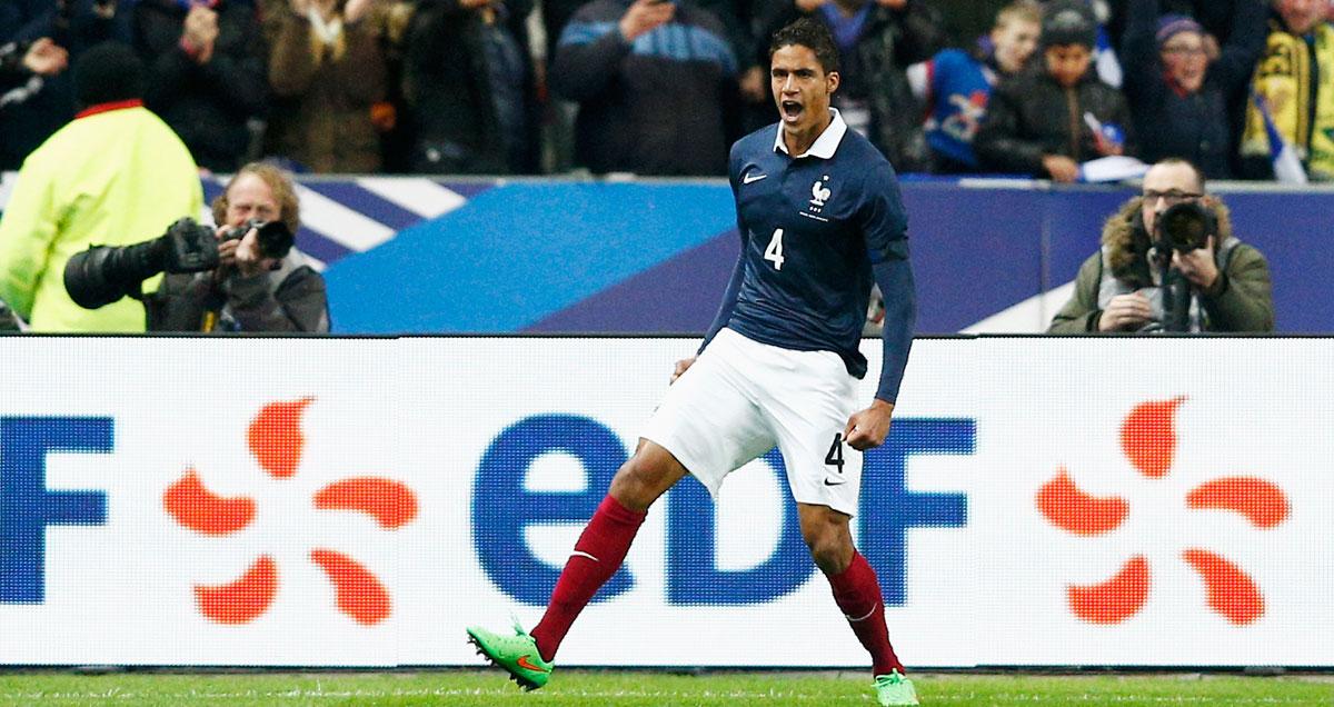 Rafael Varane celebrates scoring for France against Brazil