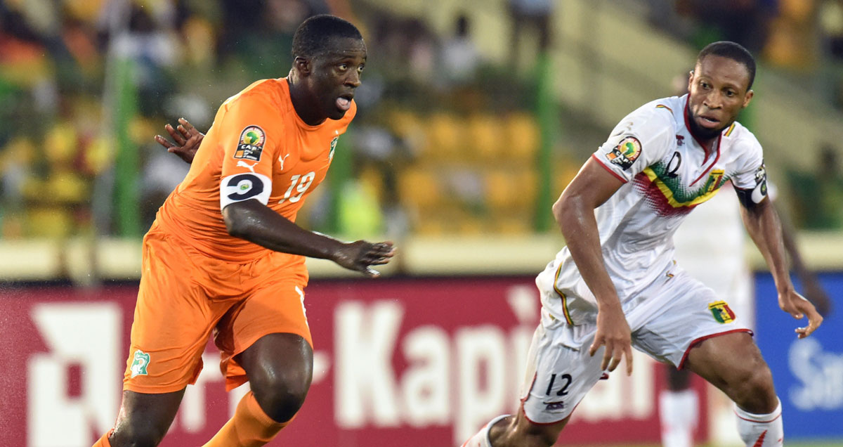 Ivory Coast's Yaya Toure has his space shut down by a patrolling Seydou Keita