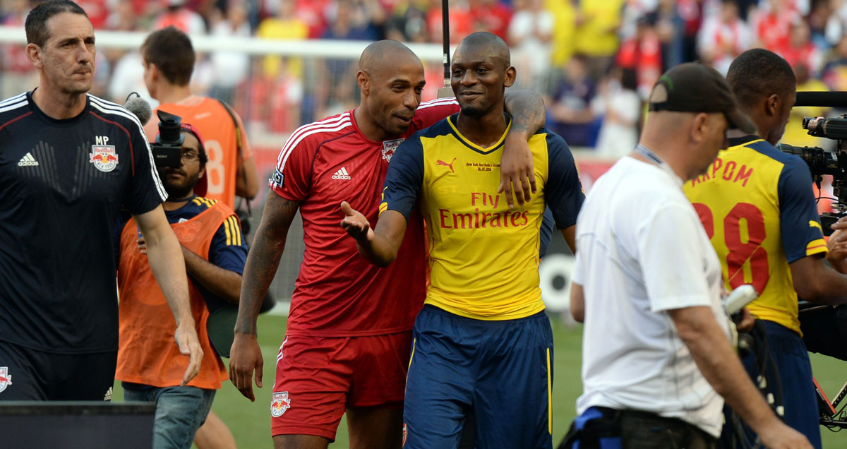 Abou Diaby and Thierry Henry embrace