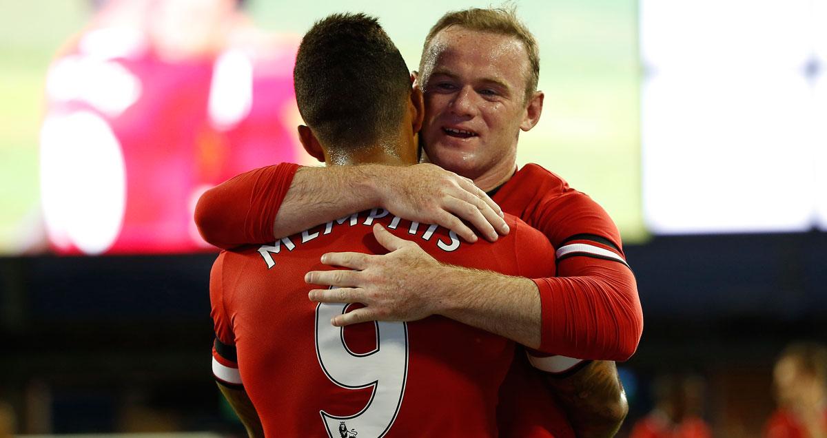 Wayne Rooney embraces new Man Utd colleague Memphis Depay