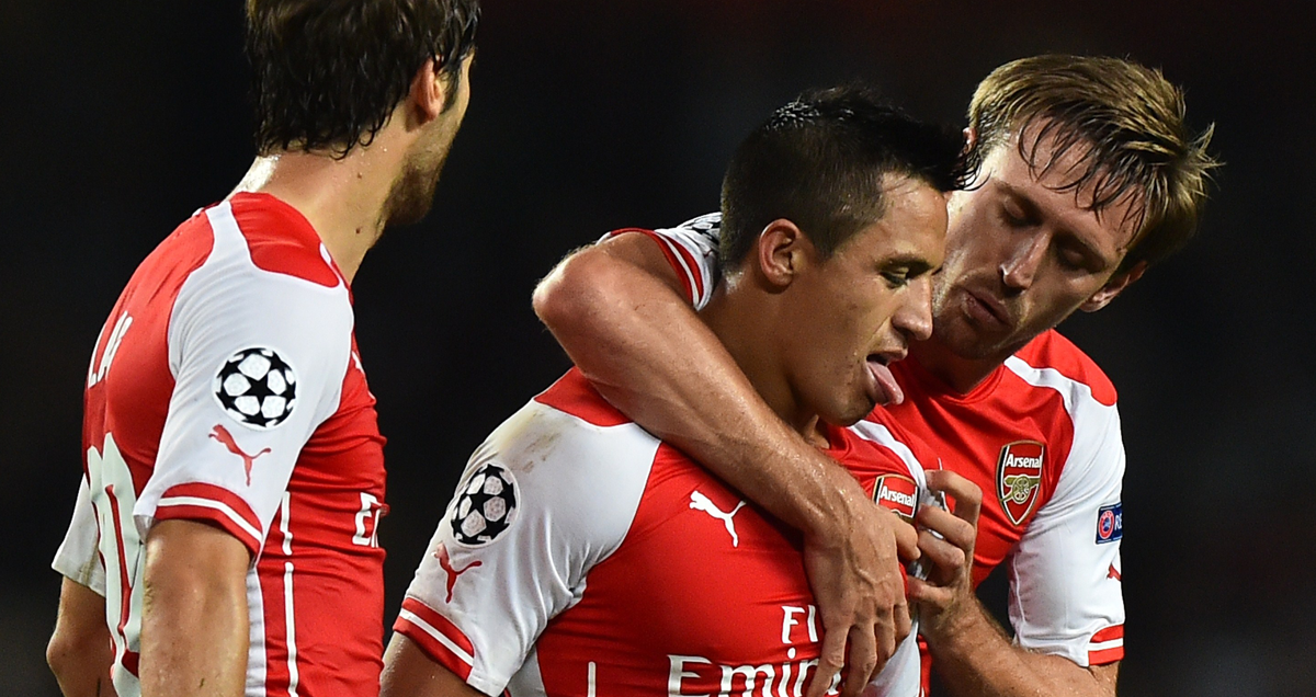 Alexis-Sanchez-is-congratulated-for-the-goal-that-secured-Arsenal's-play-off-passage-in-2014