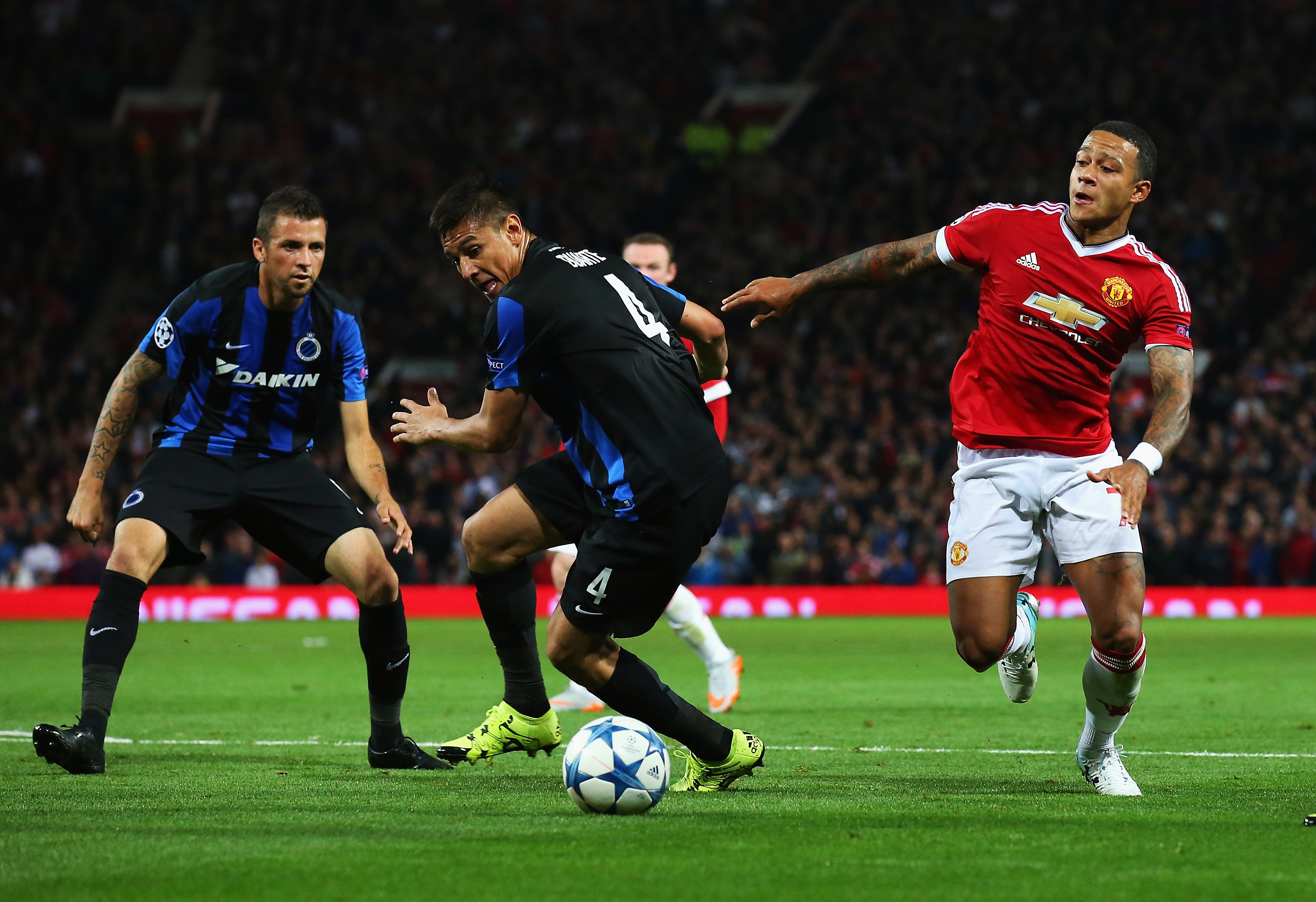 The Club Brugge backline admire the dribbling prowess of Memphis Depay