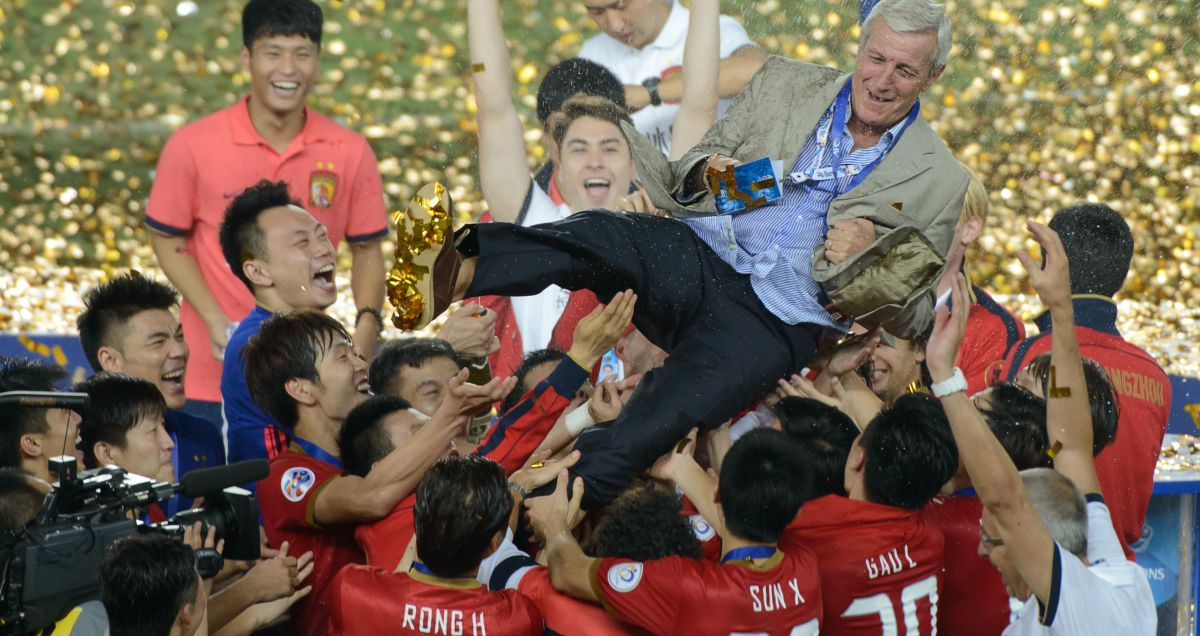 Guangzhou Evergrande players hurl Marcelo Lippi skywards after winning the AFC Champions League
