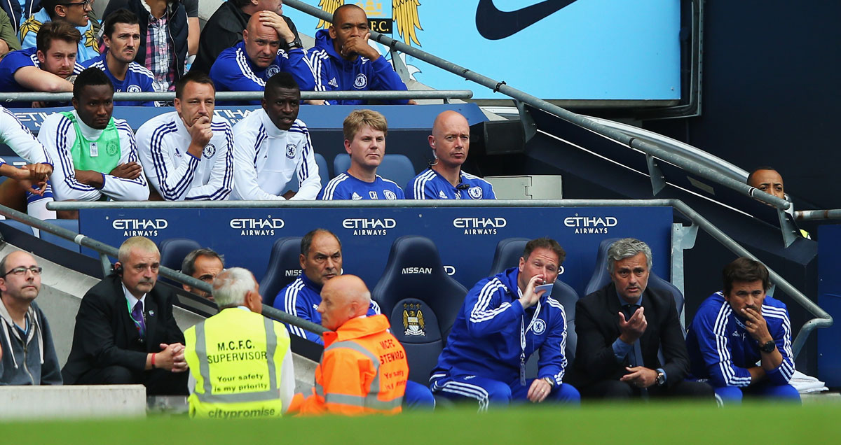 John Terry observes from the Chelsea bench at Manchester City