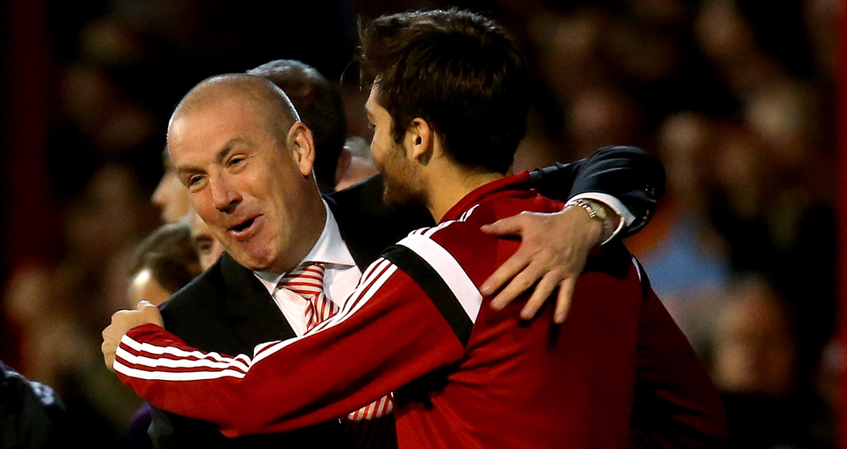 Mark Warburton embraces Arsenal loanee Jon Toral at Brentford