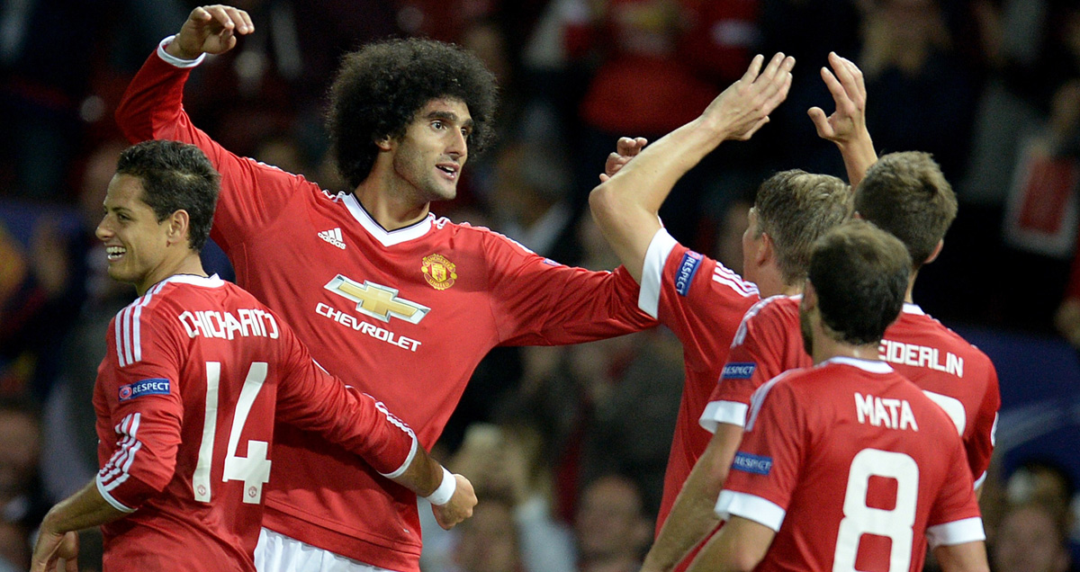 Marouane Fellaini is congratulated by Man Utd teammates against Club Brugge