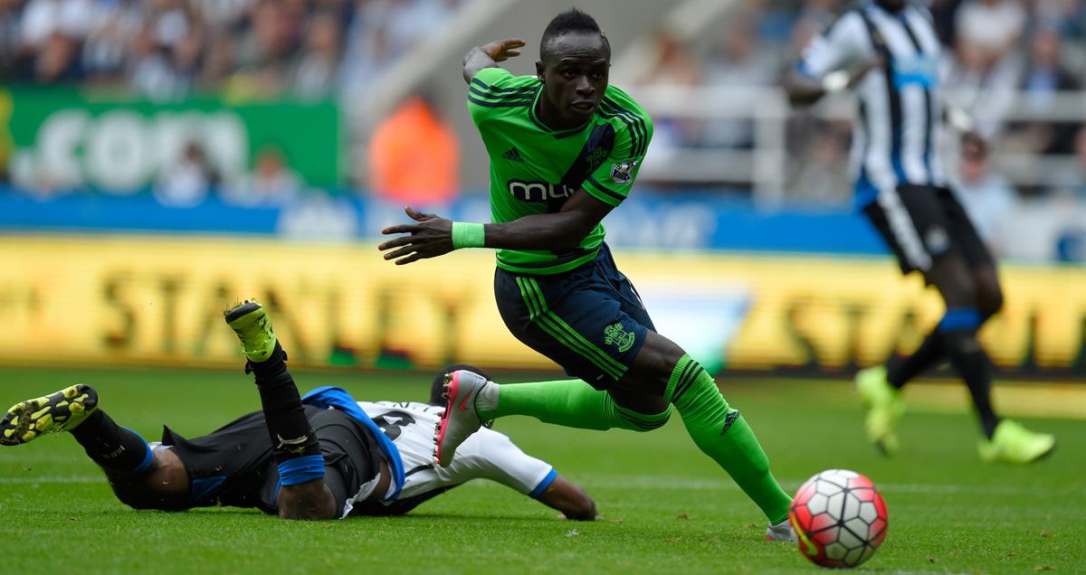 Sadio Mane leaves an opposition defender grounded