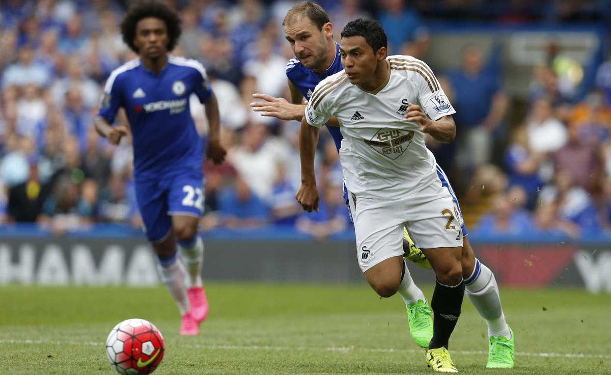 As so many wingers did in August, Jefferson Montero evades Branslav Ivanovic