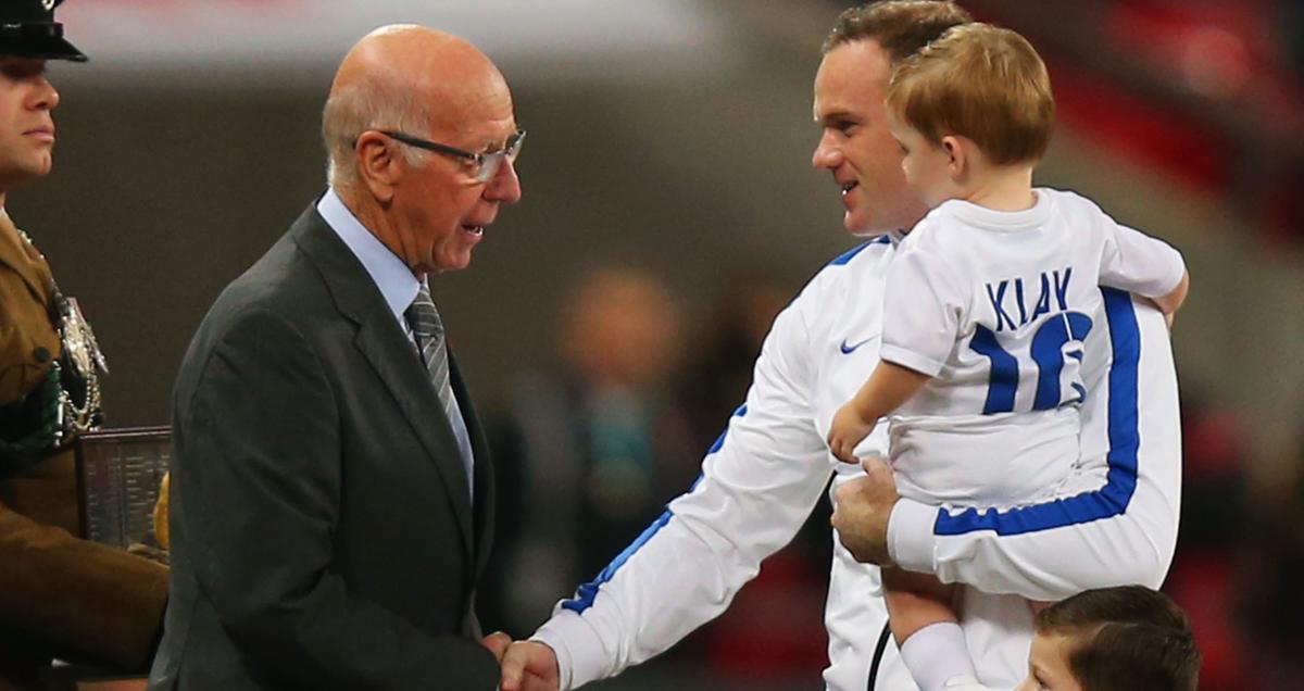 Sir Bobby Charlton awards Wayne Rooney his 100th England cap