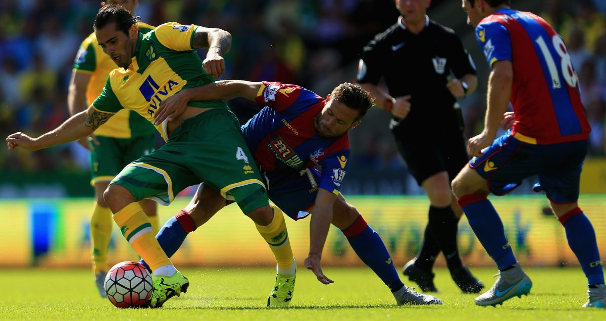 Yohan Cabaye rolls his sleeves up against Norwich