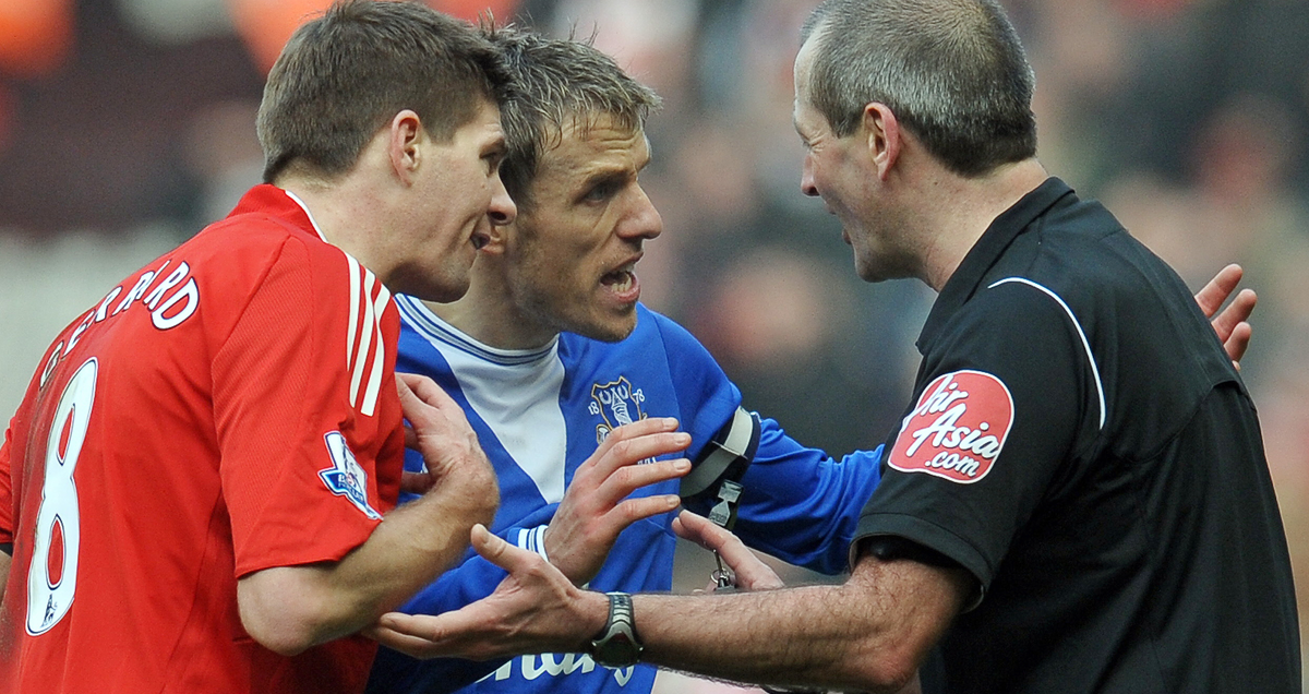 Atkinson is approached by Steven Gerrard and Phiul Neville furing the Merseyside derby of February 2010