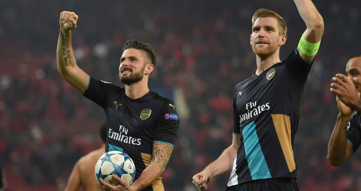 Olivier Giroud claims his match ball after scoring a hat-trick at Olympiakos