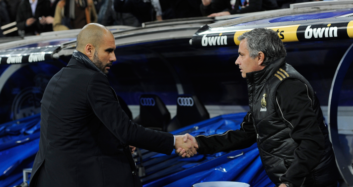 Arch rivals Jose Mourinho and Pep Guardiola shake hands