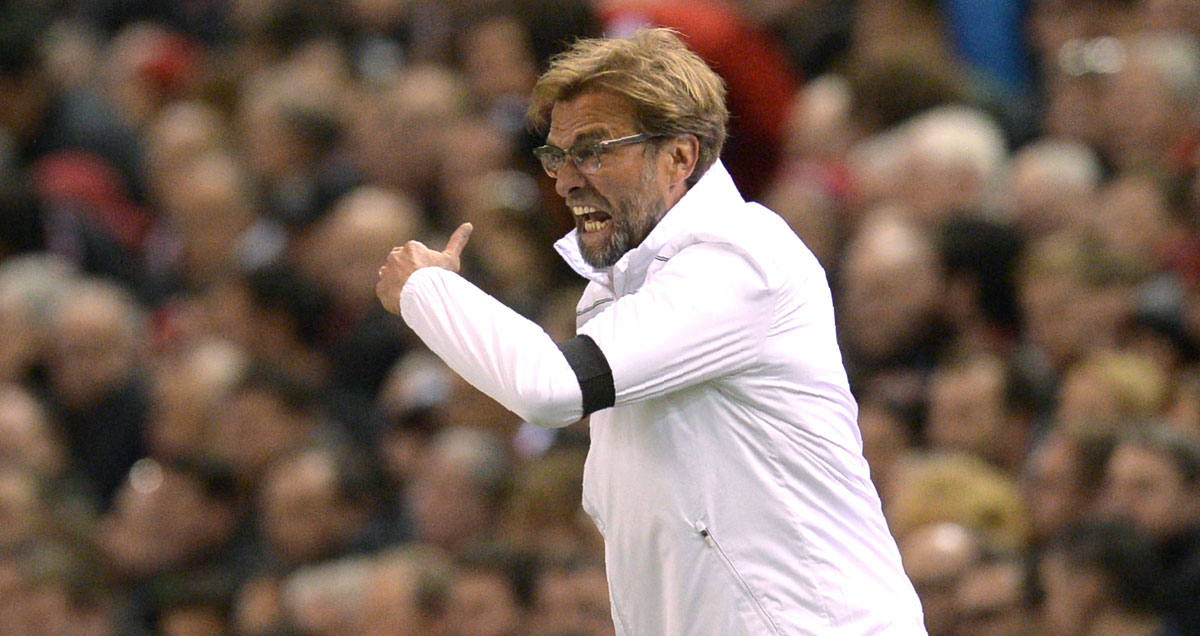 Incandescent Jurgen Klopp threatens someone with the back of his hand