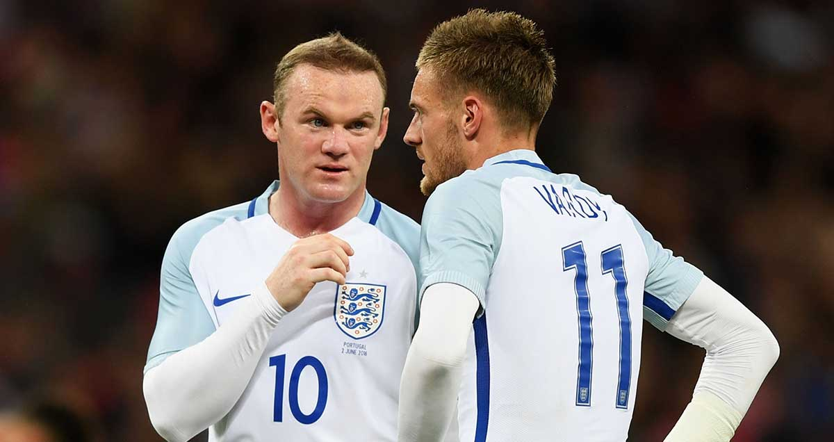 Wayne Rooney imparts some wisdom to international rookie Jamie Vardy