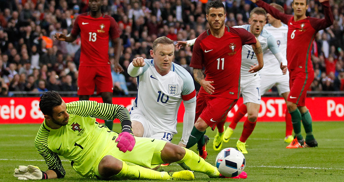Rui Patricio slide tackles Wayne Rooney in Portugal's friendly with England