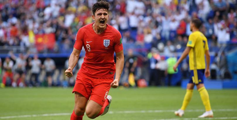 Harry Maguire celebrates scoring for England