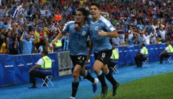 Edinson Cavani of Uruguay celebrates with Luis Suarez