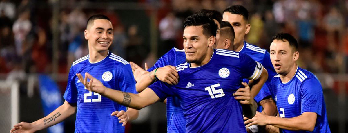 Paraguay players celebrate a goal