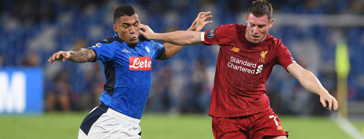 Allan of Napoli vies with James Milner of Liverpool