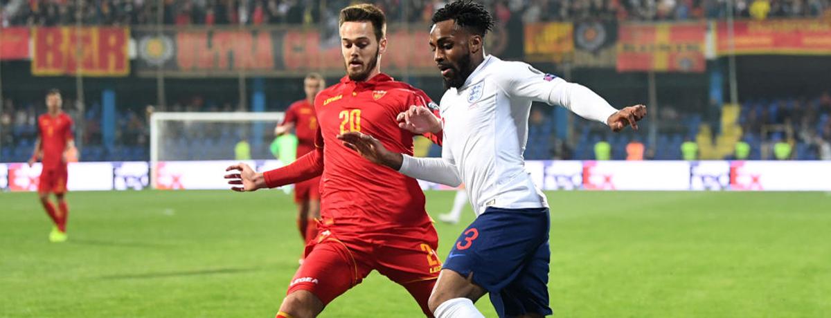 Danny Rose of England takes on Mirko Ivanic of Montenegro