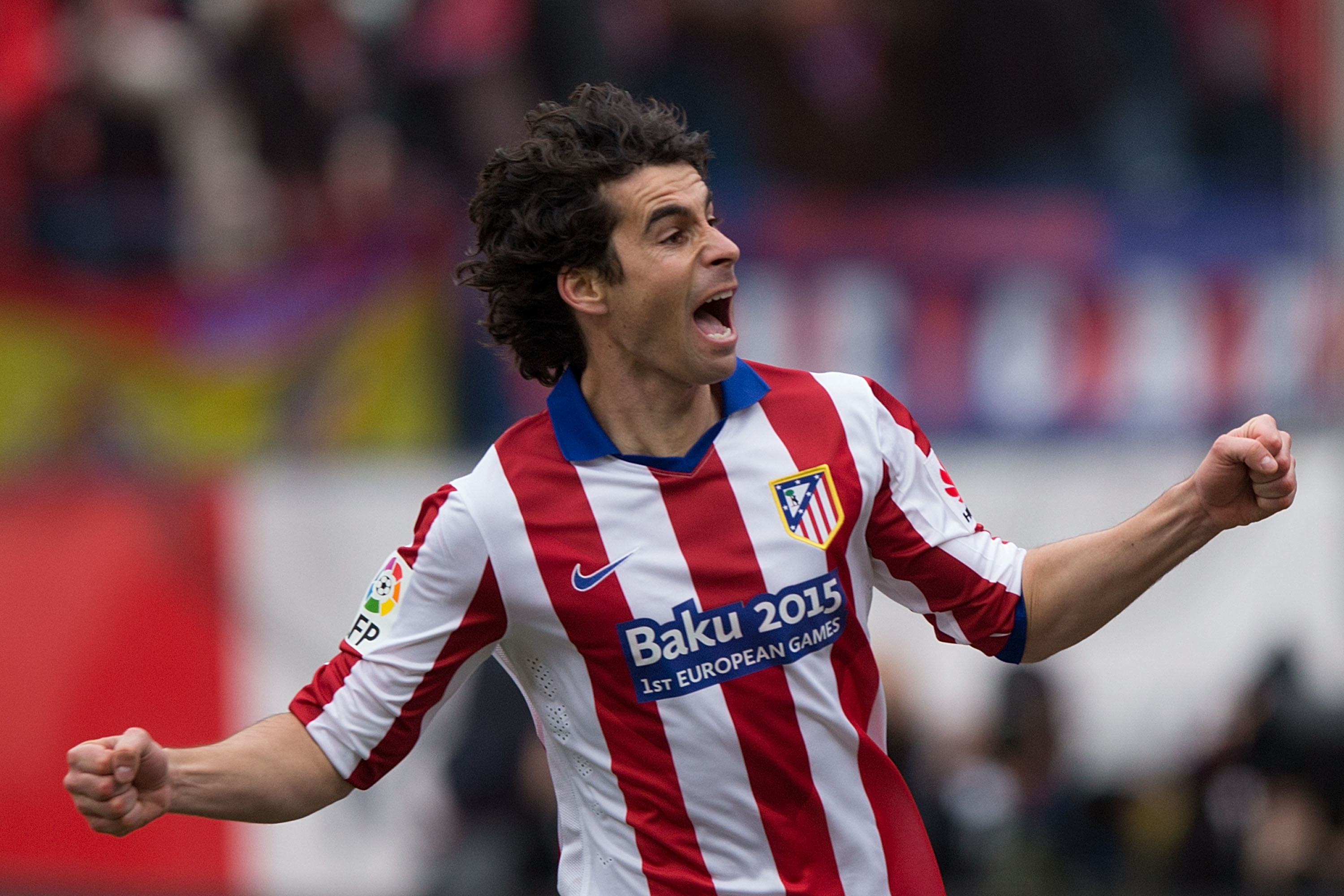 MADRID, SPAIN - FEBRUARY 07: Tiago Mendes of Atletico de Madrid celebrates scoring their opening goal during the La Liga match between Club Atletico de Madrid and Real Madrid CF at Vicente Calderon Stadium on February 7, 2015 in Madrid, Spain. (Photo by Gonzalo Arroyo Moreno/Getty Images)