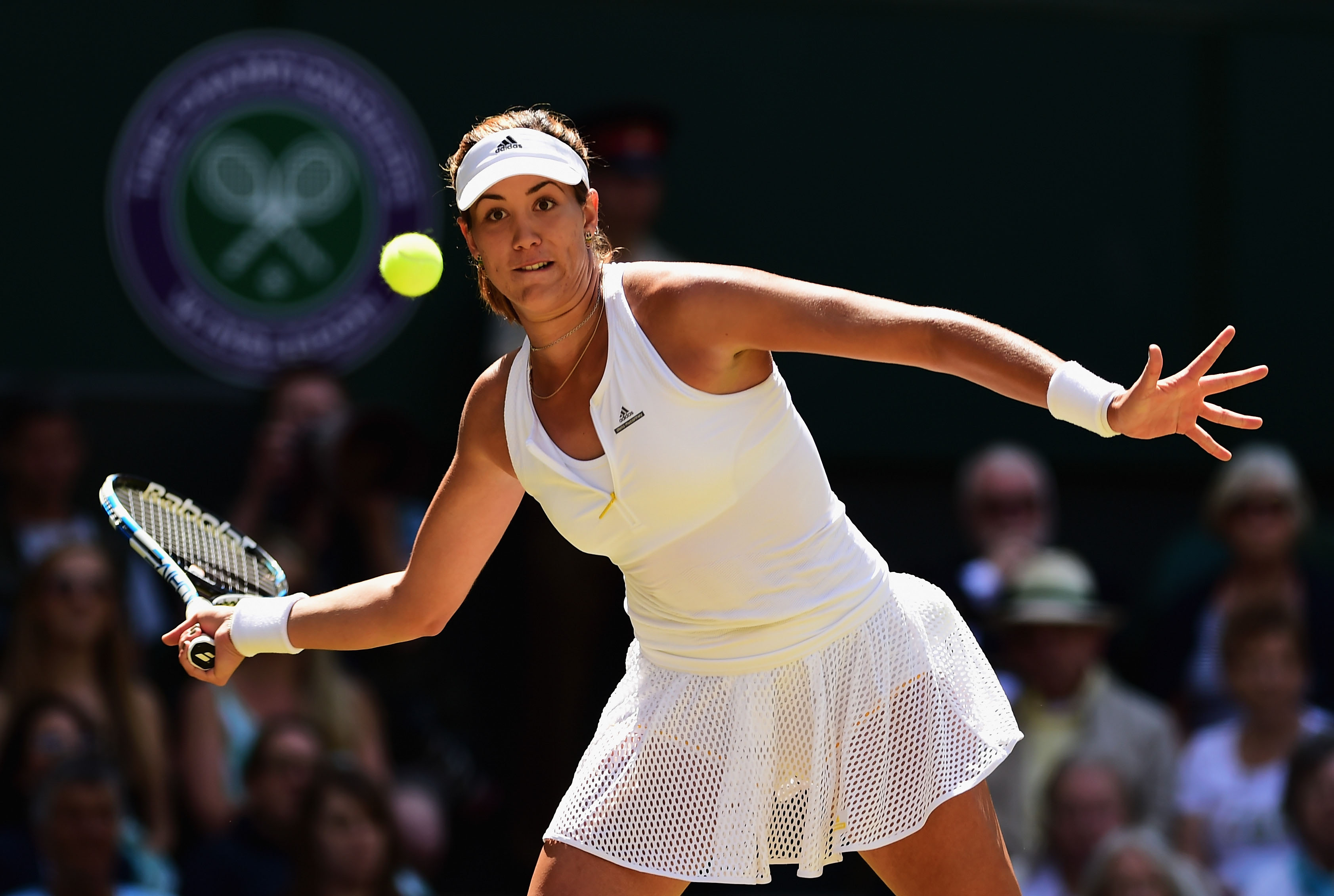LONDON, ENGLAND - JULY 09: Garbine Muguruza of Spain plays a forehand in the Ladies Singles Semi Final match against Agnieszka Radwanska of Poland during day ten of the Wimbledon Lawn Tennis Championships at the All England Lawn Tennis and Croquet Club on July 9, 2015 in London, England. (Photo by Shaun Botterill/Getty Images)