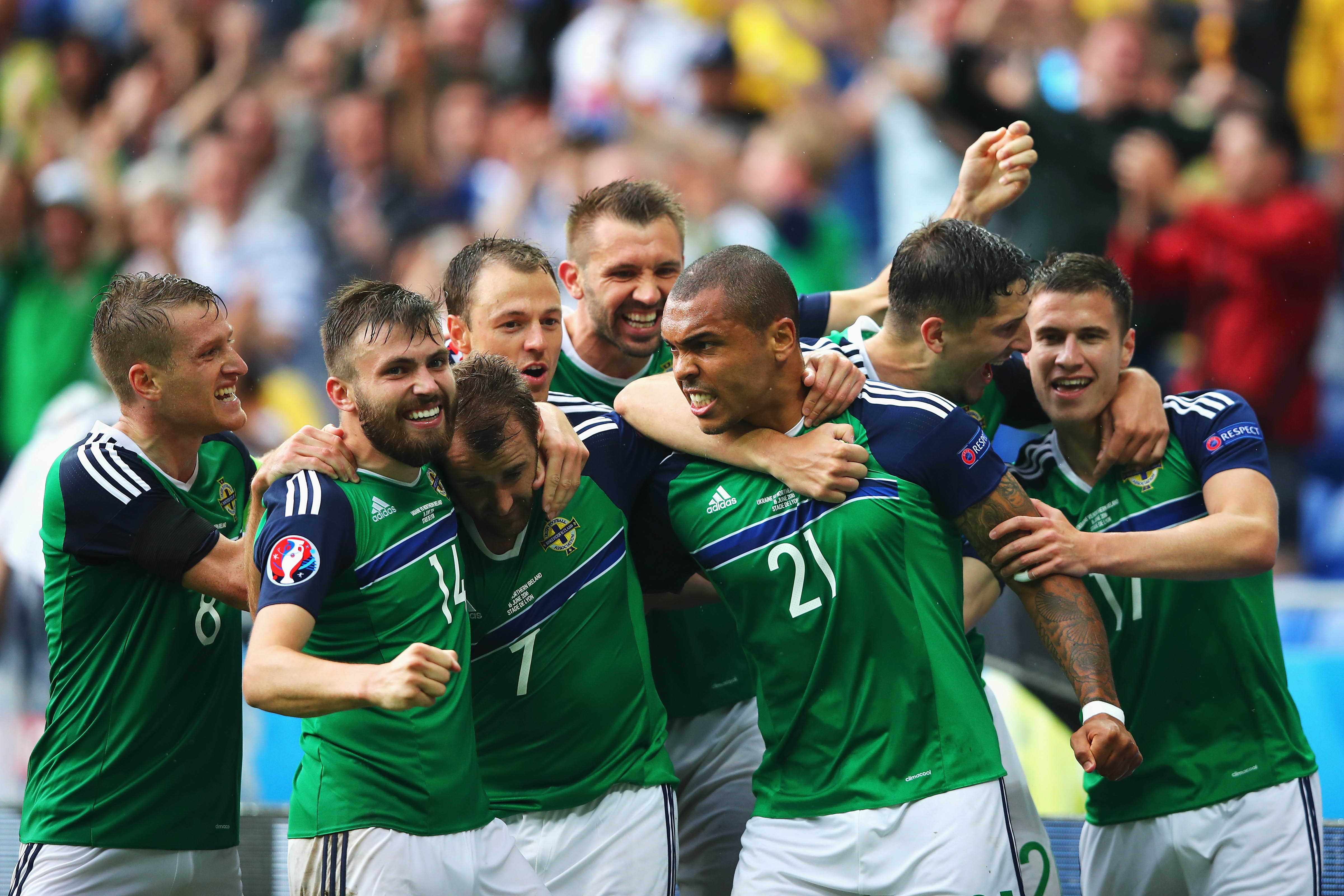 LYON, FRANCE - JUNE 16: Niall McGinn (3rd L) of Northern Ireland celebrates scoring his team's second goal with his team mates during the UEFA EURO 2016 Group C match between Ukraine and Northern Ireland at Stade des Lumieres on June 16, 2016 in Lyon, France. (Photo by Clive Brunskill/Getty Images)