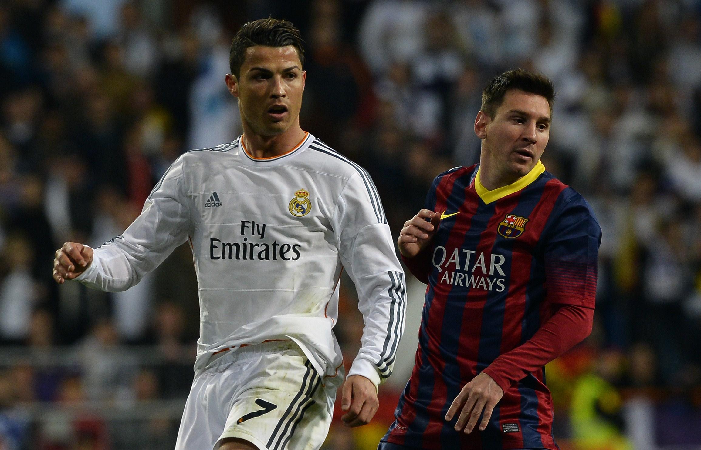 Cristiano Ronaldo y Leo Messi, en un Clásico.