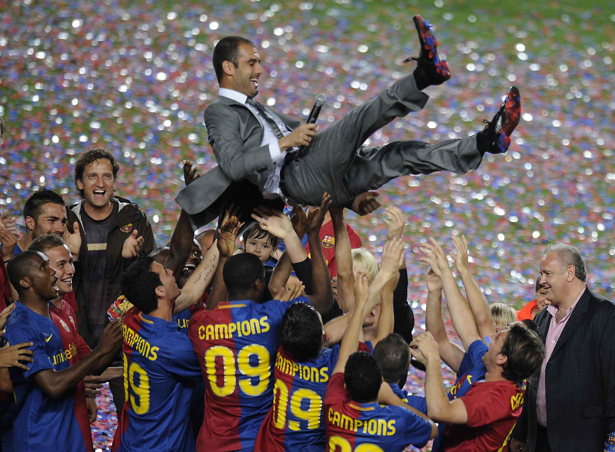 Barcelona players lift their coach Pep G