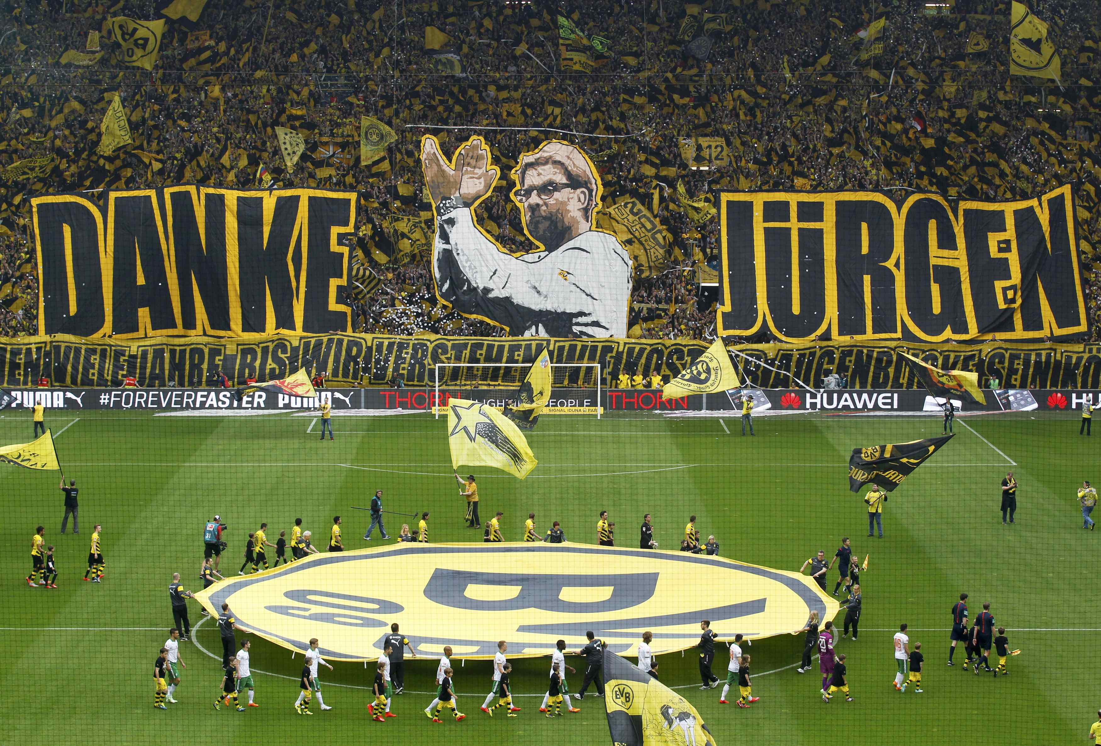 "Supporters hold up banners reading ""Thanks Juergen"" to express their gratitude to Borussia Dortmund coach Klopp before his team's first division Bundesliga soccer match against Werder Bremen in Dortmund"