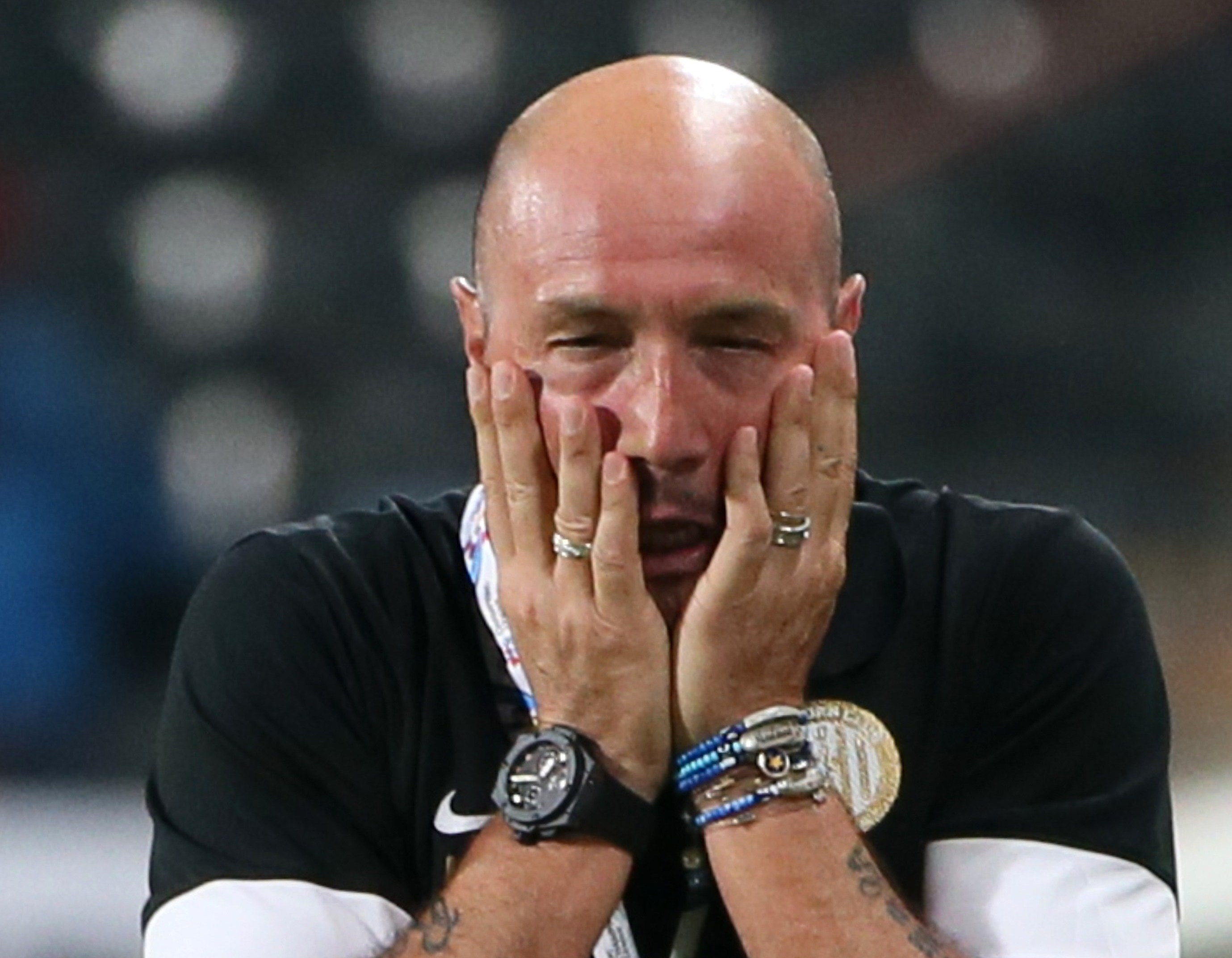 UAE's al-Jazira's coach Walter Zenga reacts during his team's AFC Champions League football match (knockout stage of the first leg) against UAE's al-Ain's on May 6, 2014 at Sheikh Mohammed Bin Zayed Stadium in Abu Dhabi. AFP PHOTO/KARIM SAHIB        (Photo credit should read KARIM SAHIB/AFP/Getty Images)