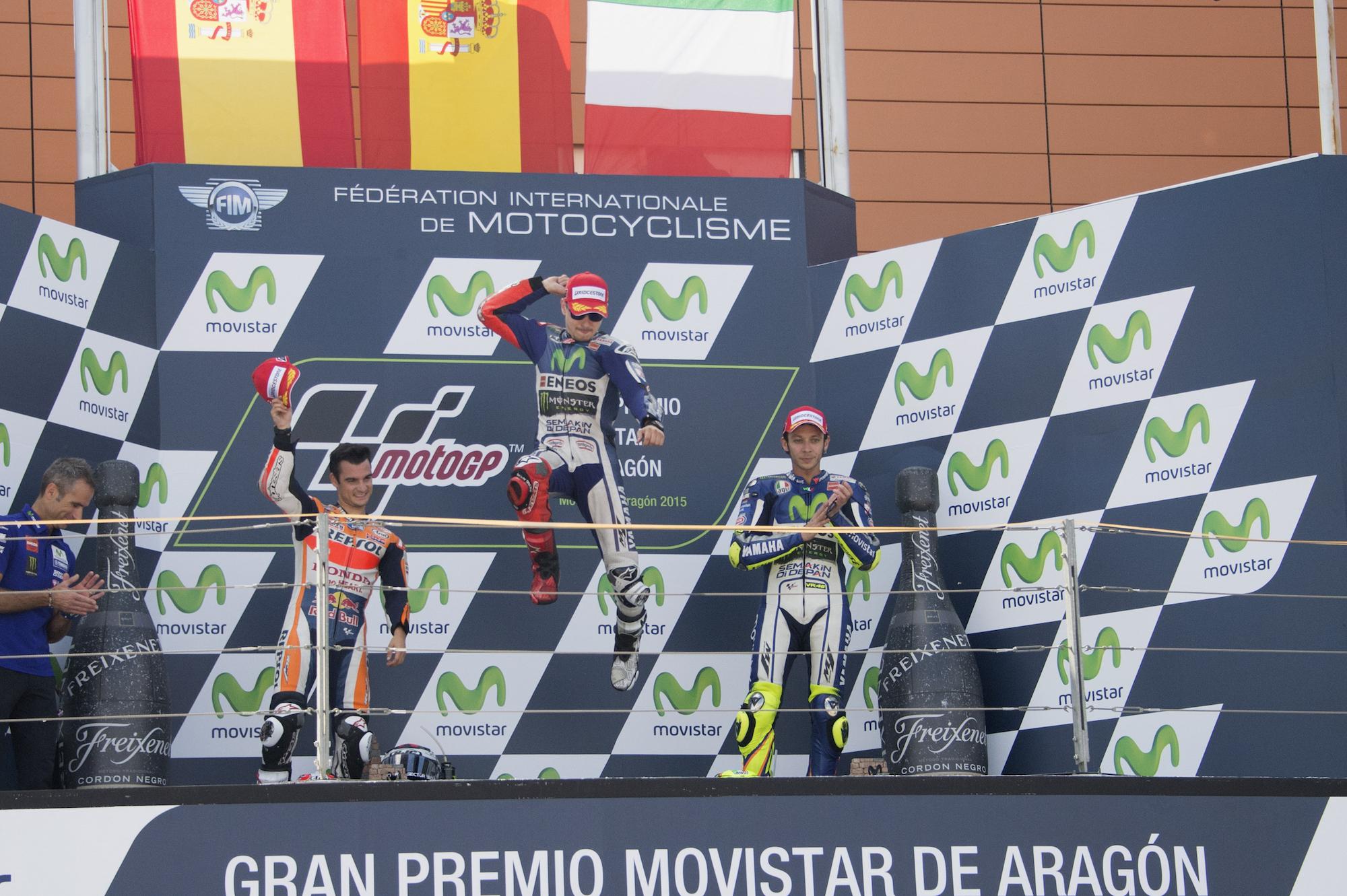 Il podio del Gran Premio di Aragon: da sinistra, Dani Pedrosa, Jorge Lorenzo e Valentino Rossi