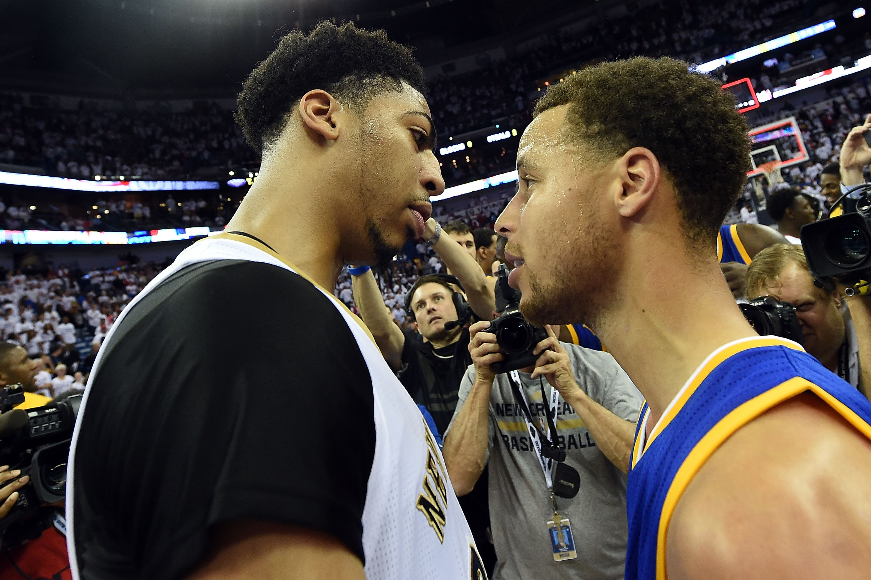 NEW ORLEANS, LA - APRIL 25: Anthony Davis #23 of the New Orleans Pelicans and Stephen Curry #30 of the Golden State Warriors speak at midcourt following Game Four in the first round of the 2015 NBA Playoffs at the Smoothie King Center on April 25, 2015 in New Orleans, Louisiana. NOTE TO USER: User expressly acknowledges and agrees that, by downloading and or using this photograph, User is consenting to the terms and conditions of the Getty Images License Agreement. (Photo by Stacy Revere/Getty Images)