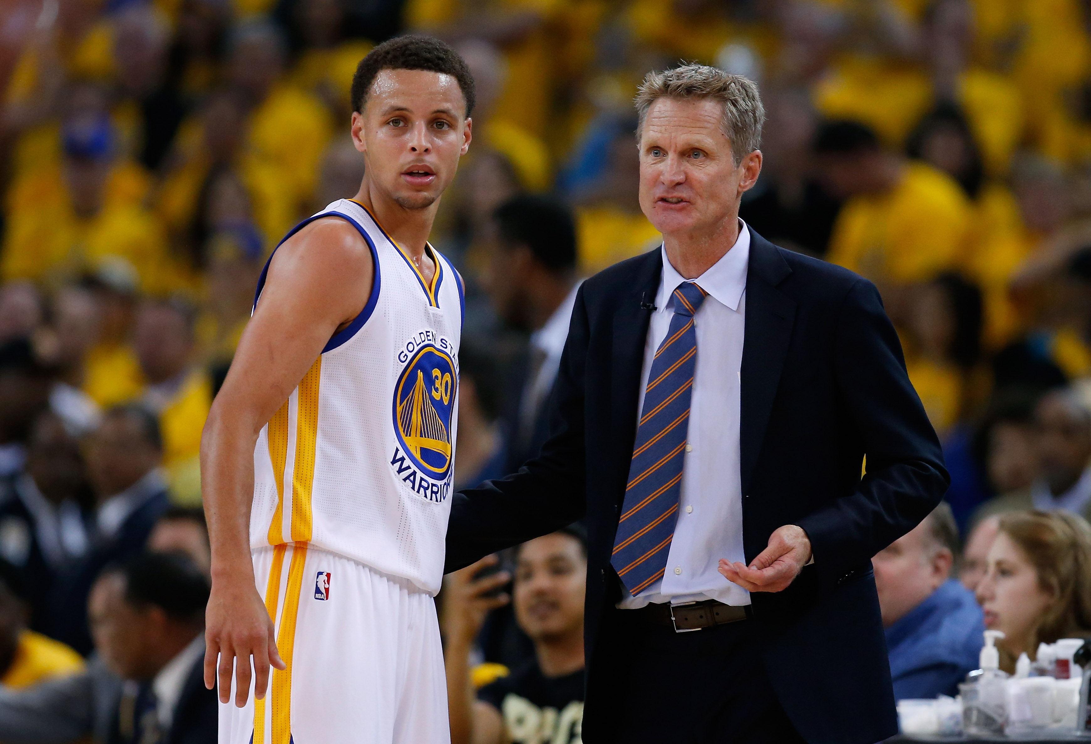 OAKLAND, CA - MAY 03: Head coach Steve Kerr of the Golden State Warriors talks to Stephen Curry #30 during their game against the Memphis Grizzlies during Game One of the Western Conference Semifinals during the NBA Playoffs on May 3, 2015 at Oracle Arena in Oakland, California. NOTE TO USER: User expressly acknowledges and agrees that, by downloading and or using this photograph, User is consenting to the terms and conditions of the Getty Images License Agreement. (Photo by Ezra Shaw/Getty Images)