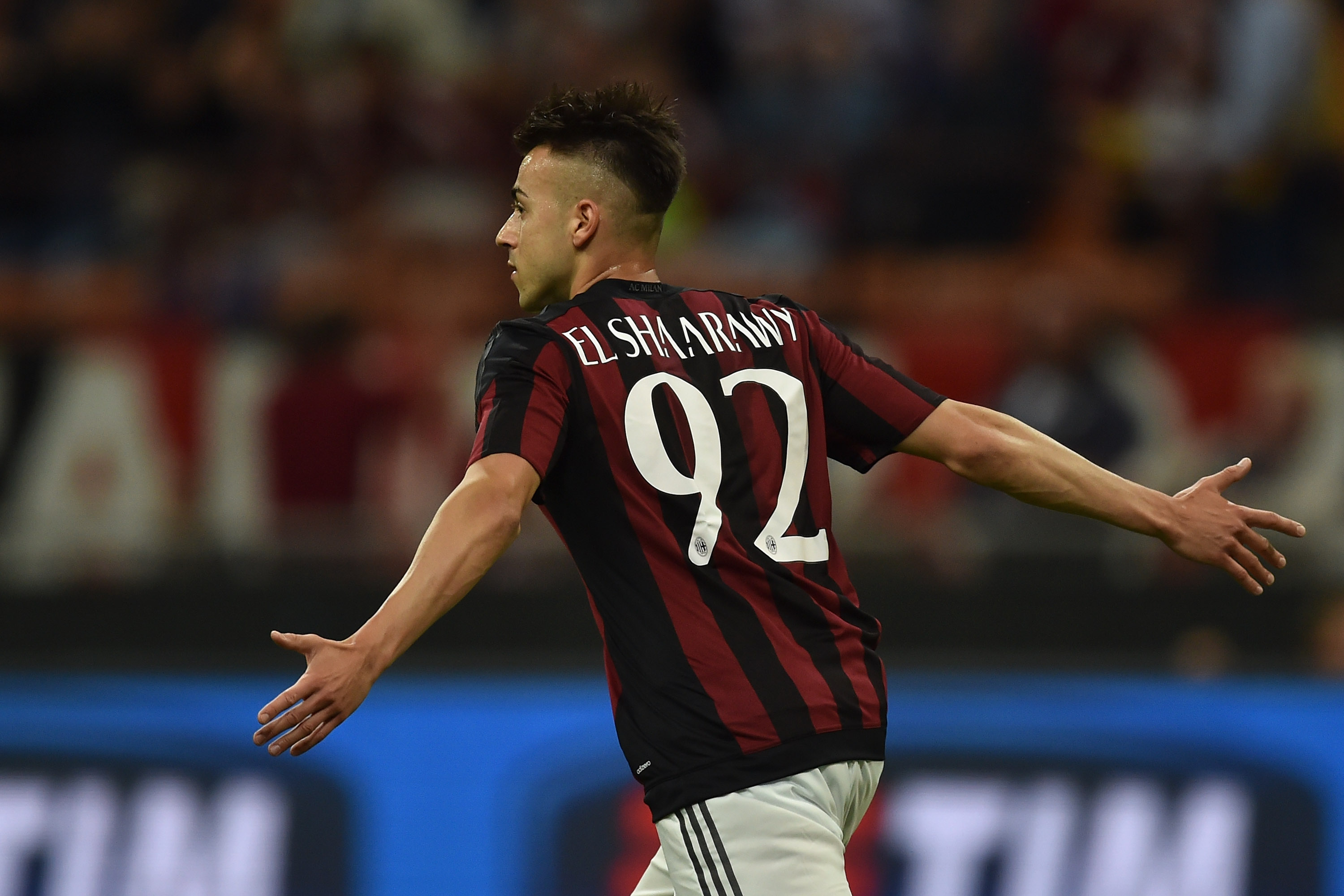 MILAN, ITALY - MAY 24: Stephan El Shaarawy of AC Milan celebrates the opening goal during the Serie A match between AC Milan and Torino FC at Stadio Giuseppe Meazza on May 24, 2015 in Milan, Italy. (Photo by Valerio Pennicino/Getty Images)