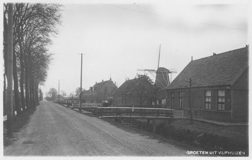 Spieringweg W 057_ 1937 met Molen de Jonge Landman.jpg