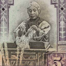 Vignette of silk making from front of a $5 Chefoo banknote