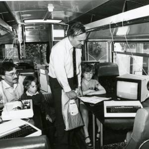RG1899 Men and boys onboard bus with computers and monitors, 28th July 1983.jpg
