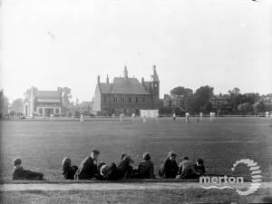 A match in progress on Cricket Green, Mitcham