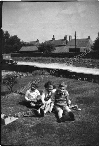 David and June Stacey with Paul Taylor at 36 Greno Cres. c.1953