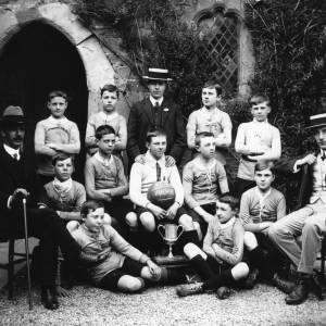 G36-045-05  Blue Coat School football team  3 men football cup 1911.jpg